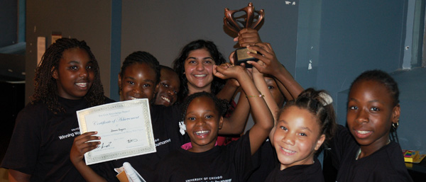 Children together with a trophy
